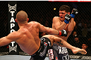 MONTREAL, QC - MARCH 16:  (R-L) Georges St-Pierre lands a kick against Nick Diaz in their welterweight championship bout during the UFC 158 event at Bell Centre on March 16, 2013 in Montreal, Quebec, Canada.  (Photo by Jonathan Ferrey/Zuffa LLC/Zuffa LLC via Getty Images)