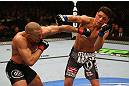 MONTREAL, QC - MARCH 16:  (L-R) Georges St-Pierre trades punches with Nick Diaz in their welterweight championship bout during the UFC 158 event at Bell Centre on March 16, 2013 in Montreal, Quebec, Canada.  (Photo by Jonathan Ferrey/Zuffa LLC/Zuffa LLC via Getty Images)