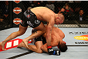 MONTREAL, QC - MARCH 16:  Georges St-Pierre throws a knee to the body of Nick Diaz in their welterweight championship bout during the UFC 158 event at Bell Centre on March 16, 2013 in Montreal, Quebec, Canada.  (Photo by Jonathan Ferrey/Zuffa LLC/Zuffa LLC via Getty Images)