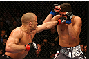 MONTREAL, QC - MARCH 16:  (L-R) Georges St-Pierre lands a punch against Nick Diaz in their welterweight championship bout during the UFC 158 event at Bell Centre on March 16, 2013 in Montreal, Quebec, Canada.  (Photo by Jonathan Ferrey/Zuffa LLC/Zuffa LLC via Getty Images)
