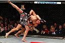 MONTREAL, QC - MARCH 16:  (L-R) Georges St-Pierre takes down Nick Diaz in their welterweight championship bout during the UFC 158 event at Bell Centre on March 16, 2013 in Montreal, Quebec, Canada.  (Photo by Josh Hedges/Zuffa LLC/Zuffa LLC via Getty Images)