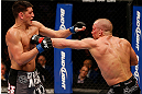 MONTREAL, QC - MARCH 16:  (R-L) Georges St-Pierre punches Nick Diaz in their welterweight championship bout during the UFC 158 event at Bell Centre on March 16, 2013 in Montreal, Quebec, Canada.  (Photo by Josh Hedges/Zuffa LLC/Zuffa LLC via Getty Images)