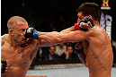 MONTREAL, QC - MARCH 16:  (R-L) Nick Diaz punches Georges St-Pierre in their welterweight championship bout during the UFC 158 event at Bell Centre on March 16, 2013 in Montreal, Quebec, Canada.  (Photo by Josh Hedges/Zuffa LLC/Zuffa LLC via Getty Images)
