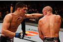 MONTREAL, QC - MARCH 16:  (L-R) Nick Diaz punches Georges St-Pierre in their welterweight championship bout during the UFC 158 event at Bell Centre on March 16, 2013 in Montreal, Quebec, Canada.  (Photo by Josh Hedges/Zuffa LLC/Zuffa LLC via Getty Images)