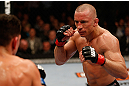 MONTREAL, QC - MARCH 16:  (R-L) Georges St-Pierre squares off with Nick Diaz in their welterweight championship bout during the UFC 158 event at Bell Centre on March 16, 2013 in Montreal, Quebec, Canada.  (Photo by Josh Hedges/Zuffa LLC/Zuffa LLC via Getty Images)