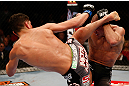 MONTREAL, QC - MARCH 16:  (L-R) Nick Diaz kicks Georges St-Pierre in their welterweight championship bout during the UFC 158 event at Bell Centre on March 16, 2013 in Montreal, Quebec, Canada.  (Photo by Josh Hedges/Zuffa LLC/Zuffa LLC via Getty Images)