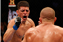 MONTREAL, QC - MARCH 16:  (L-R) Nick Diaz taunts Georges St-Pierre in their welterweight championship bout during the UFC 158 event at Bell Centre on March 16, 2013 in Montreal, Quebec, Canada.  (Photo by Josh Hedges/Zuffa LLC/Zuffa LLC via Getty Images)