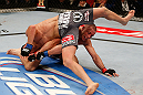 MONTREAL, QC - MARCH 16:  (L-R) Nick Diaz attempts to escape from bottom position against Georges St-Pierre in their welterweight championship bout during the UFC 158 event at Bell Centre on March 16, 2013 in Montreal, Quebec, Canada.  (Photo by Josh Hedges/Zuffa LLC/Zuffa LLC via Getty Images)