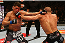 MONTREAL, QC - MARCH 16:  (R-L) Georges St-Pierre punches Nick Diaz in their welterweight championship bout during the UFC 158 event at Bell Centre on March 16, 2013 in Montreal, Quebec, Canada.  (Photo by Jonathan Ferrey/Zuffa LLC/Zuffa LLC via Getty Images)
