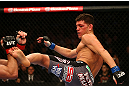MONTREAL, QC - MARCH 16:  (R-L) Nick Diaz kicks Georges St-Pierre in their welterweight championship bout during the UFC 158 event at Bell Centre on March 16, 2013 in Montreal, Quebec, Canada.  (Photo by Jonathan Ferrey/Zuffa LLC/Zuffa LLC via Getty Images)