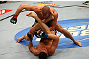 MONTREAL, QC - MARCH 16:  Georges St-Pierre (top) punches Nick Diaz in their welterweight championship bout during the UFC 158 event at Bell Centre on March 16, 2013 in Montreal, Quebec, Canada.  (Photo by Jonathan Ferrey/Zuffa LLC/Zuffa LLC via Getty Images)