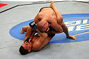 MONTREAL, QC - MARCH 16:  (L-R) Nick Diaz attempts a submission against Georges St-Pierre in their welterweight championship bout during the UFC 158 event at Bell Centre on March 16, 2013 in Montreal, Quebec, Canada.  (Photo by Jonathan Ferrey/Zuffa LLC/Zuffa LLC via Getty Images)