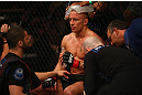 MONTREAL, QC - MARCH 16:  Georges St-Pierre sits in his corner between rounds of his welterweight championship bout against Nick Diaz during the UFC 158 event at Bell Centre on March 16, 2013 in Montreal, Quebec, Canada.  (Photo by Jonathan Ferrey/Zuffa LLC/Zuffa LLC via Getty Images)