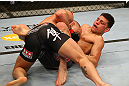 MONTREAL, QC - MARCH 16:  (R-L) Nick Diaz and Georges St-Pierre grapple in their welterweight championship bout during the UFC 158 event at Bell Centre on March 16, 2013 in Montreal, Quebec, Canada.  (Photo by Jonathan Ferrey/Zuffa LLC/Zuffa LLC via Getty Images)
