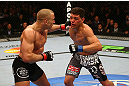 MONTREAL, QC - MARCH 16:  (L-R) Georges St-Pierre punches Nick Diaz in their welterweight championship bout during the UFC 158 event at Bell Centre on March 16, 2013 in Montreal, Quebec, Canada.  (Photo by Jonathan Ferrey/Zuffa LLC/Zuffa LLC via Getty Images)