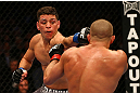 MONTREAL, QC - MARCH 16:  (L-R) Nick Diaz punches Georges St-Pierre in their welterweight championship bout during the UFC 158 event at Bell Centre on March 16, 2013 in Montreal, Quebec, Canada.  (Photo by Jonathan Ferrey/Zuffa LLC/Zuffa LLC via Getty Images)