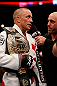 MONTREAL, QC - MARCH 16:  (L-R) Georges St-Pierre is interviewed by Joe Rogan after his victory over Nick Diaz in their welterweight championship bout during the UFC 158 event at Bell Centre on March 16, 2013 in Montreal, Quebec, Canada.  (Photo by Josh Hedges/Zuffa LLC/Zuffa LLC via Getty Images)