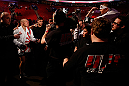 MONTREAL, QC - MARCH 16:  Georges St-Pierre greets a young fan on his way out of the arena after his victory over Nick Diaz in their welterweight championship bout during the UFC 158 event at Bell Centre on March 16, 2013 in Montreal, Quebec, Canada.  (Photo by Josh Hedges/Zuffa LLC/Zuffa LLC via Getty Images)
