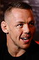 STOCKHOLM, SWEDEN - APRIL 03:  Ross Pearson of England interacts with media during an interview session at the Grand Hotel on April 3, 2013 in Stockholm, Sweden.  (Photo by Josh Hedges/Zuffa LLC/Zuffa LLC via Getty Images)