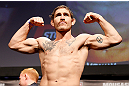 STOCKHOLM, SWEDEN - APRIL 05:  Tom Lawlor weighs in during the UFC weigh-in at the Ericsson Globe Arena on April 5, 2013 in Stockholm, Sweden.  (Photo by Josh Hedges/Zuffa LLC/Zuffa LLC via Getty Images)