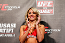 STOCKHOLM, SWEDEN - APRIL 05:  UFC Octagon Girl Carly Baker stands on stage during the UFC weigh-in at the Ericsson Globe Arena on April 5, 2013 in Stockholm, Sweden.  (Photo by Josh Hedges/Zuffa LLC/Zuffa LLC via Getty Images)