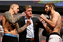 STOCKHOLM, SWEDEN - APRIL 05:  (L-R) Opponents Ross Pearson and Ryan Couture face off during the UFC weigh-in at the Ericsson Globe Arena on April 5, 2013 in Stockholm, Sweden.  (Photo by Josh Hedges/Zuffa LLC/Zuffa LLC via Getty Images)