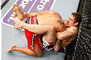 STOCKHOLM, SWEDEN - APRIL 06:  (R-L) Tom Lawlor secures a guillotine choke submission against Michael Kuiper in their middleweight fight at the Ericsson Globe Arena on April 6, 2013 in Stockholm, Sweden.  (Photo by Josh Hedges/Zuffa LLC/Zuffa LLC via Getty Images)