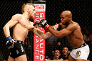 STOCKHOLM, SWEDEN - APRIL 06:  (L-R) Conor McGregor punches Marcus Brimage in their featherweight fight at the Ericsson Globe Arena on April 6, 2013 in Stockholm, Sweden.  (Photo by Josh Hedges/Zuffa LLC/Zuffa LLC via Getty Images)