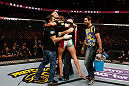 STOCKHOLM, SWEDEN - APRIL 06:  Reza Madadi celebrates with his teammates after his submission victory over Michael Johnson in their lightweight fight at the Ericsson Globe Arena on April 6, 2013 in Stockholm, Sweden.  (Photo by Josh Hedges/Zuffa LLC/Zuffa LLC via Getty Images)