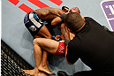 STOCKHOLM, SWEDEN - APRIL 06:  (R-L) Reza Madadi secures a choke submission against Michael Johnson in their lightweight fight at the Ericsson Globe Arena on April 6, 2013 in Stockholm, Sweden.  (Photo by Josh Hedges/Zuffa LLC/Zuffa LLC via Getty Images)