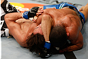 STOCKHOLM, SWEDEN - APRIL 06:  (R-L) Diego Brandao secures an arm triangle choke submission against Pablo Garza in their featherweight fight at the Ericsson Globe Arena on April 6, 2013 in Stockholm, Sweden.  (Photo by Josh Hedges/Zuffa LLC/Zuffa LLC via Getty Images)