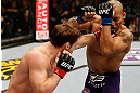 STOCKHOLM, SWEDEN - APRIL 06:  (L-R) Brad Pickett punches Mike Easton in their bantamweight fight at the Ericsson Globe Arena on April 6, 2013 in Stockholm, Sweden.  (Photo by Josh Hedges/Zuffa LLC/Zuffa LLC via Getty Images)