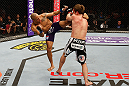 STOCKHOLM, SWEDEN - APRIL 06:  (L-R) Mike Easton kicks Brad Pickett in their bantamweight fight at the Ericsson Globe Arena on April 6, 2013 in Stockholm, Sweden.  (Photo by Josh Hedges/Zuffa LLC/Zuffa LLC via Getty Images)