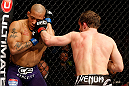 STOCKHOLM, SWEDEN - APRIL 06:  (R-L) Brad Pickett punches Mike Easton in their bantamweight fight at the Ericsson Globe Arena on April 6, 2013 in Stockholm, Sweden.  (Photo by Josh Hedges/Zuffa LLC/Zuffa LLC via Getty Images)