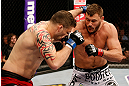 STOCKHOLM, SWEDEN - APRIL 06:  (R-L) Matt Mitrione drops Phil De Fries with a right in their heavyweight fight at the Ericsson Globe Arena on April 6, 2013 in Stockholm, Sweden.  (Photo by Josh Hedges/Zuffa LLC/Zuffa LLC via Getty Images)
