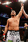 STOCKHOLM, SWEDEN - APRIL 06:  Matt Mitrione reacts after knocking out Phil De Fries in their heavyweight fight at the Ericsson Globe Arena on April 6, 2013 in Stockholm, Sweden.  (Photo by Josh Hedges/Zuffa LLC/Zuffa LLC via Getty Images)