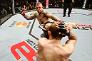 STOCKHOLM, SWEDEN - APRIL 06:  (L-R) Ross Pearson kicks Ryan Couture in their lightweight fight at the Ericsson Globe Arena on April 6, 2013 in Stockholm, Sweden.  (Photo by Josh Hedges/Zuffa LLC/Zuffa LLC via Getty Images)
