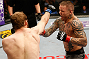 STOCKHOLM, SWEDEN - APRIL 06:  (L-R) Ryan Couture punches Ross Pearson in their lightweight fight at the Ericsson Globe Arena on April 6, 2013 in Stockholm, Sweden.  (Photo by Josh Hedges/Zuffa LLC/Zuffa LLC via Getty Images)