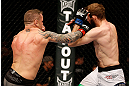 STOCKHOLM, SWEDEN - APRIL 06:  (L-R) Ross Pearson punches Ryan Couture in their lightweight fight at the Ericsson Globe Arena on April 6, 2013 in Stockholm, Sweden.  (Photo by Josh Hedges/Zuffa LLC/Zuffa LLC via Getty Images)