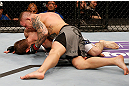 STOCKHOLM, SWEDEN - APRIL 06:  (R-L) Ross Pearson punches Ryan Couture in their lightweight fight at the Ericsson Globe Arena on April 6, 2013 in Stockholm, Sweden.  (Photo by Josh Hedges/Zuffa LLC/Zuffa LLC via Getty Images)