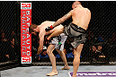 STOCKHOLM, SWEDEN - APRIL 06:  (R-L) Ross Pearson kicks Ryan Couture in their lightweight fight at the Ericsson Globe Arena on April 6, 2013 in Stockholm, Sweden.  (Photo by Josh Hedges/Zuffa LLC/Zuffa LLC via Getty Images)