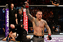STOCKHOLM, SWEDEN - APRIL 06:  (R-L) Ross Pearson reacts after defeating Ryan Couture in their lightweight fight at the Ericsson Globe Arena on April 6, 2013 in Stockholm, Sweden.  (Photo by Josh Hedges/Zuffa LLC/Zuffa LLC via Getty Images)