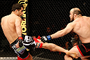 STOCKHOLM, SWEDEN - APRIL 06:  (L-R) Gegard Mousasi kicks Ilir Latifi in their light heavyweight fight at the Ericsson Globe Arena on April 6, 2013 in Stockholm, Sweden.  (Photo by Josh Hedges/Zuffa LLC/Zuffa LLC via Getty Images)