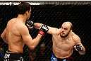 STOCKHOLM, SWEDEN - APRIL 06:  (R-L) Ilir Latifi punches Gegard Mousasi in their light heavyweight fight at the Ericsson Globe Arena on April 6, 2013 in Stockholm, Sweden.  (Photo by Josh Hedges/Zuffa LLC/Zuffa LLC via Getty Images)
