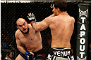 STOCKHOLM, SWEDEN - APRIL 06:  (L-R) Ilir Latifi punches Gegard Mousasi in their light heavyweight fight at the Ericsson Globe Arena on April 6, 2013 in Stockholm, Sweden.  (Photo by Josh Hedges/Zuffa LLC/Zuffa LLC via Getty Images)