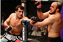 STOCKHOLM, SWEDEN - APRIL 06:  (L-R) Gegard Mousasi punches Ilir Latifi in their light heavyweight fight at the Ericsson Globe Arena on April 6, 2013 in Stockholm, Sweden.  (Photo by Josh Hedges/Zuffa LLC/Zuffa LLC via Getty Images)