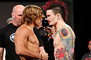 LAS VEGAS, NV - APRIL 12: (L-R) Opponents Urijah Faber and Scott Jorgensen face off during the TUF 17 Finale weigh-in at the Hollywood Theatre at the MGM Grand Hotel/Casino on April 12, 2013 in Las Vegas, Nevada. (Photo by Josh Hedges/Zuffa LLC/Zuffa LLC via Getty Images)
