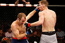 LAS VEGAS, NV - APRIL 13:   (L-R) Collin Hart punches Luke Barnatt in their middleweight fight at the Mandalay Bay Events Center  on April 13, 2013 in Las Vegas, Nevada.  (Photo by Josh Hedges/Zuffa LLC/Zuffa LLC via Getty Images)  *** Local Caption *** Luke Barnatt; Collin Hart