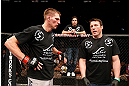 LAS VEGAS, NV - APRIL 13:   (L-R) Collin Hart speaks with Chael Sonnen after his middleweight fight at the Mandalay Bay Events Center  on April 13, 2013 in Las Vegas, Nevada.  (Photo by Josh Hedges/Zuffa LLC/Zuffa LLC via Getty Images)  *** Local Caption *** Luke Barnatt; Collin Hart