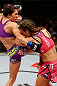 LAS VEGAS, NV - APRIL 13:   (L-R) Cat Zingano knees Miesha Tate in their bantamweight fight at the Mandalay Bay Events Center  on April 13, 2013 in Las Vegas, Nevada.  (Photo by Josh Hedges/Zuffa LLC/Zuffa LLC via Getty Images)  *** Local Caption *** Miesha Tate; Cat Zingano